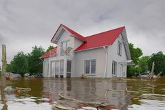 3d render - flooding blue house. 3d render of a flooding white house - force of nature Stock Photos