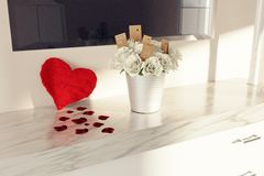3d render of fluffy heart and bouquet of white roses on white ma. Rble dressing table to congratulate mother`s day Stock Image