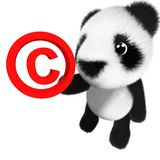 3d Funny cartoon baby panda bear character holding a copyright symbol. 3d render of a funny cartoon baby panda bear character holding a copyright symbol Royalty Free Stock Photo