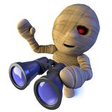 3d Funny cartoon Egyptian mummy monster character holding a pair of binoculars. 3d render of a funny cartoon Egyptian mummy monster character holding a pair of Royalty Free Stock Image