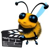 3d Funny cartoon honey bee character holding a movie makers clapperboard stock illustration