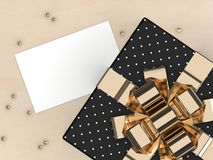 3d render of gift with blank card. Lying on wooden desk Royalty Free Stock Images