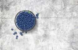 Glass bowl full of blueberries on wooden table stock images