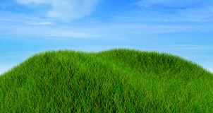 3D render of a grass landscape against a cloudy blue sky Stock Image