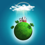 3D render of a grassy globe with a house and trees under rainbow Royalty Free Stock Photography