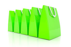 3d render - green shopping bags. 3d render - Five green shopping bags over white background Stock Images