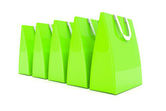 3d render - green shopping bags. 3d render - Five green shopping bags over white background Royalty Free Stock Images