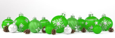 3d render - green and silver christmas baubles over white backgr. 3d render of many green and silver christmas baubles and christmas decorations over white Royalty Free Stock Photo