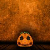 3D Halloween jack o lantern in grunge interior Stock Image
