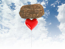3d render of heart balloon carrying a heavy rock Stock Photos