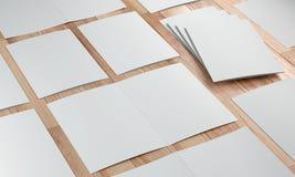3d render illustration of a leaflet mockup on wood background. Perspective view stock illustration