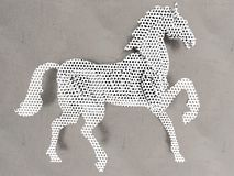 Metal horse cutout. 3D render illustration of a metallic horse cutout. The composition is positioned on a grey metallic background Royalty Free Stock Images