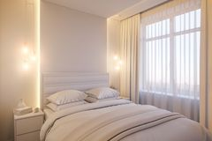 3d render of an interior design of a white minimalist bedroom. Royalty Free Stock Images