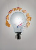 3d render light bulb with pencil saw dust. On paper background as creative concept Royalty Free Stock Images