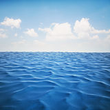 3d render of ocean and beautiful blue sky Royalty Free Stock Photo