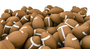 American footballs pile. 3D render of piled american footballs Stock Photography