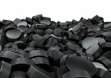 Hockey pucks pile Stock Images