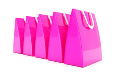 3d render - pink shopping bags. 3d render - Five pink shopping bags over white background Stock Image