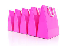 3d render - pink shopping bags. 3d render - Five pink shopping bags over white background Stock Photos