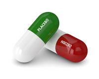 3D render of placebo and nocebo pills over white. 3D render of placebo and noicebo pills isolated over white background Royalty Free Stock Image