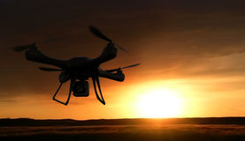 3d render quadrocopters silhouette in the background. radio-cont. Rolled toy is filming nature. Unmanned flying drone sunset Stock Photo