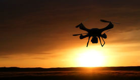 3d render quadrocopters silhouette in the background. radio-cont Stock Photo