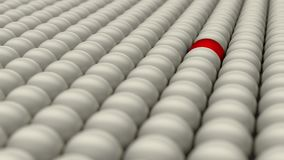 Be different, standing out of the crowd, red ball surrounded by white balls, concept, 3D render. 3D render of a red ball surrounded with white balls. Concept of Stock Photos