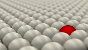 Be different, standing out of the crowd, red ball surrounded by white balls, concept, 3D render Stock Image