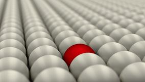 Be different, standing out of the crowd, red ball surrounded by white balls, concept, 3D render. 3D render of a red ball surrounded with white balls. Concept of Stock Images