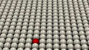 Be different, standing out of the crowd, red ball surrounded by white balls, concept, 3D render. 3D render of a red ball surrounded with white balls. Concept of Royalty Free Stock Photos