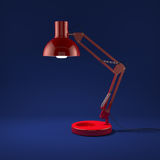 Lamp illuminating. 3d render of red lamp illuminating on blue background Royalty Free Stock Photos