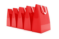 3d render - red shopping bags. 3d render - Five red shopping bags over white background Royalty Free Stock Photo