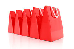 3d render - red shopping bags. 3d render - Five red shopping bags over white background Stock Photo
