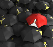 3d render Red umbrella stand out from the crowd of many black an Stock Photo