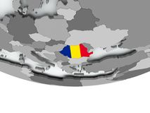 Romania with flag on globe Stock Photo