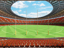 3D render of a round Australian rules football stadium with  orange chairs. 3D render of a round Australian rules football stadium with  orange seats and VIP Stock Photos