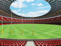 3D render of a round Australian rules football stadium with  red seats. And VIP boxes for fifty thousand fans Stock Photos