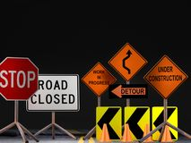 Road construction signs. 3D render of set of various American road construction signs against black background Royalty Free Stock Photo