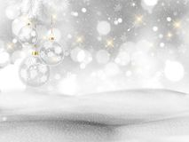 3D snowy landscape with hanging Christmas decorations. 3D render of a snowy landscape with hanging Christmas decorations Royalty Free Stock Image