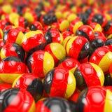 3d render - soccer balls. Footballs - germany Royalty Free Stock Photos