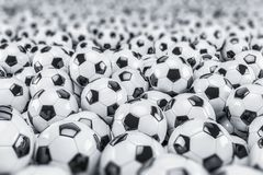 3d render - soccer balls. Footballs - balls - depth of field Royalty Free Stock Photo