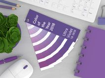 3d render of stationery with color palette guide. Lying on wooden desk. Ultraviolet. Color of the year 2018 Stock Photos