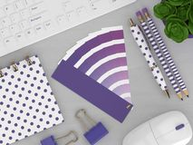 3d render of stationery with color palette guide. Lying on wooden desk. Ultraviolet. Color of the year 2018 Royalty Free Stock Image