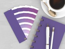 3d render of stationery with color palette guide. Lying on wooden desk. Ultraviolet. Color of the year 2018 Stock Photo