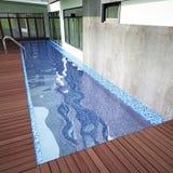 3D render of swiming pool. In backyard Royalty Free Stock Photo