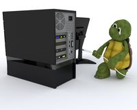 Tortoise with a computer Stock Photography