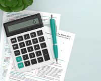 3d render of UK tax form with calculator. Lying on wooden desk with place for text Stock Images