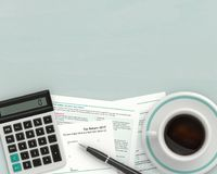 3d render of UK tax form with calculator. Lying on wooden desk with place for text Royalty Free Stock Photography