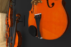 Violins hung on the wall. 3d render of Violins hung on the wall Royalty Free Stock Image
