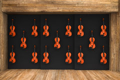 Violins hung on the wall. 3d render of Violins hung on the wall Stock Image